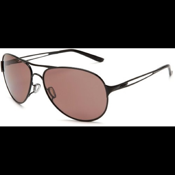 f0857fd9475a2 Oakley women s Caveat Polarized Sunglasses. M 5c2c0627df0307d6ee60eafa